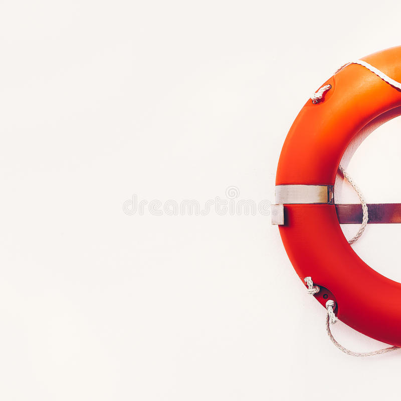 Lifebuoy hanging on white wall. Vintage style stock photography