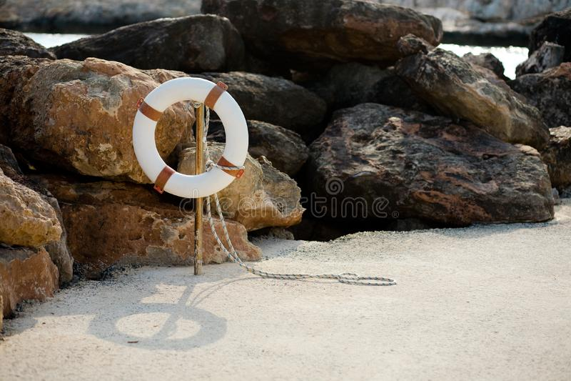 Download Lifebuoy Hangs On A Stick On The Beach Stock Photo - Image of float, sand: 19599622