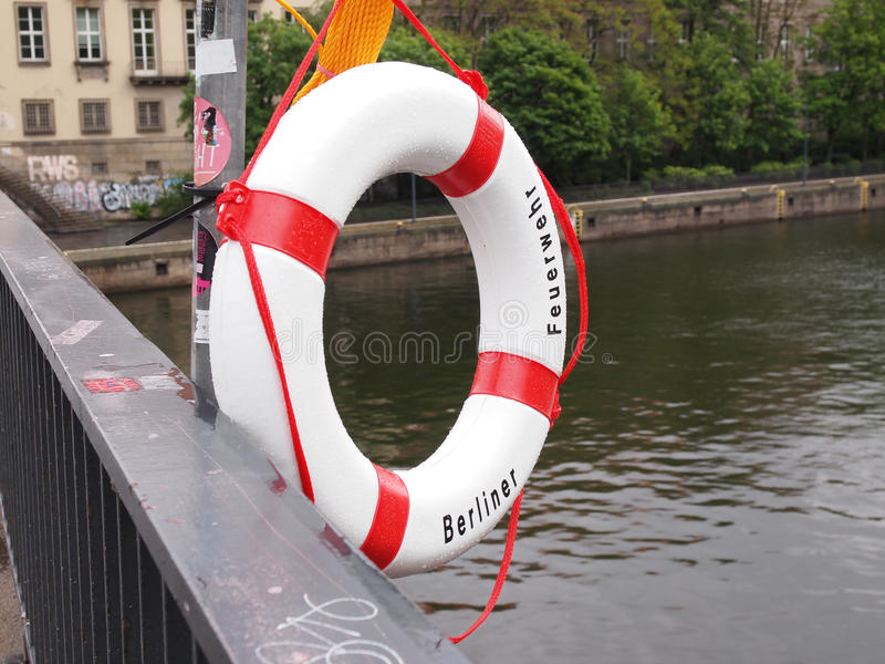 Lifebuoy. A life buoy of Berliner Feuerwehr meaning Berlin Fire Department on river Sprea in Berlin royalty free stock photo