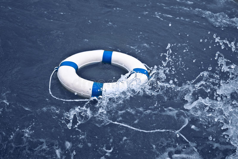Lifebuoy, lifebelt, lifesaver in ocean storm as help, hope concept royalty free stock images