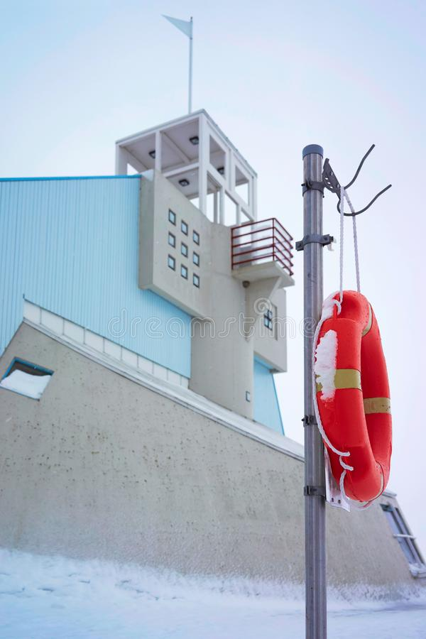 Lifebuoy and Lighthouse at Baltic Sea in winter Oulu. Lifebuoy and Lighthouse at the Baltic Sea in winter Oulu, Lapland, Finland stock image