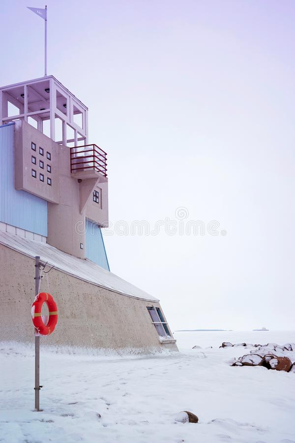 Lifebuoy and Lighthouse in Baltic Sea in winter Oulu. Lifebuoy and Lighthouse in the Baltic Sea in winter Oulu, Lapland, Finland stock photography