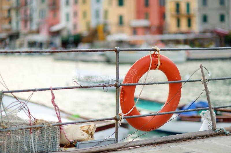 Lifebuoy in marina of Porto Venere town, a part of the Italian Riviera, Italy. Lifebuoy in marina of Porto Venere town, located in the province of La Spezia in stock photos