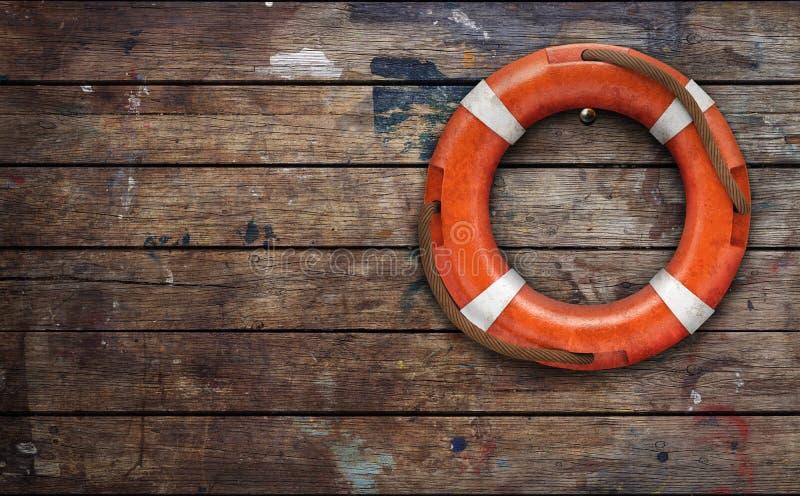 Lifebuoy na szorstkiej drewnianej ?cianie zdjęcia royalty free
