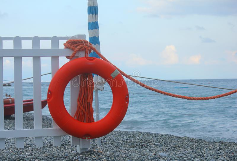 Lifebuoy on the palisade in front of the sea royalty free stock image