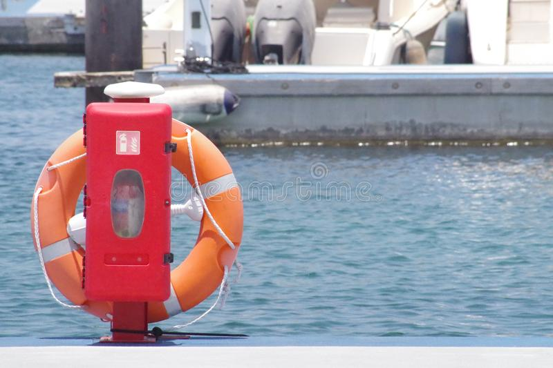 Lifebuoy in position ready to be deployed if needed. Floating device. Lifebuoy in position ready to be deployed if needed. Floating device for emergency stock images