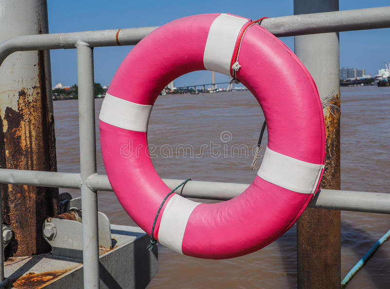 Lifebuoy ring hanging on the dock royalty free stock images