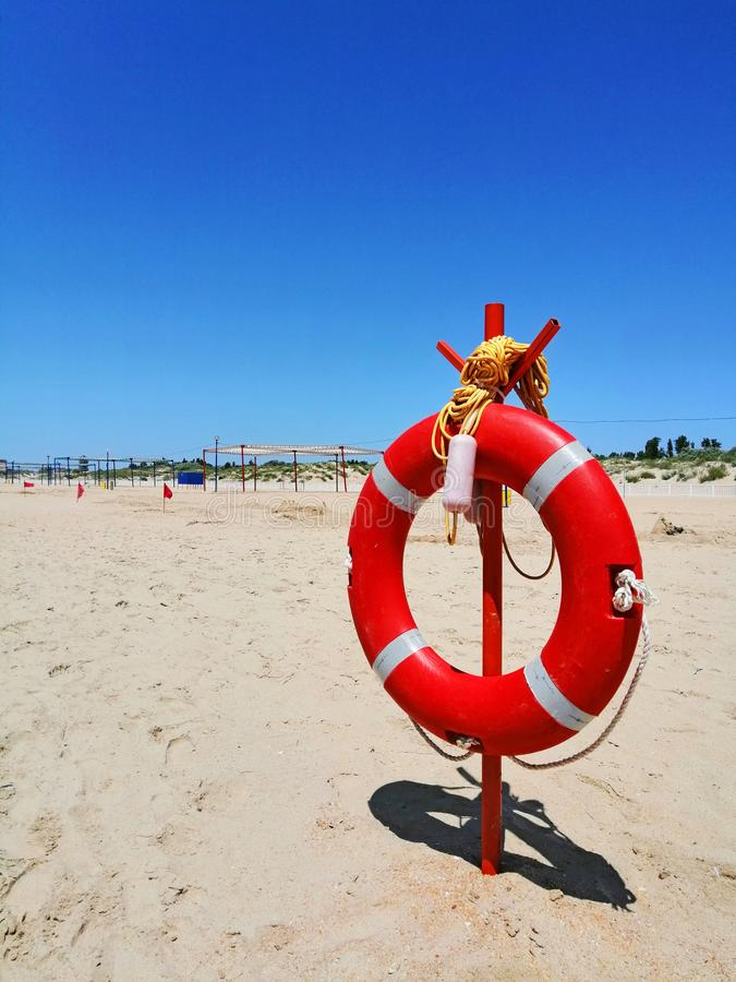 Lifebuoy on a sandy beach royalty free stock photos