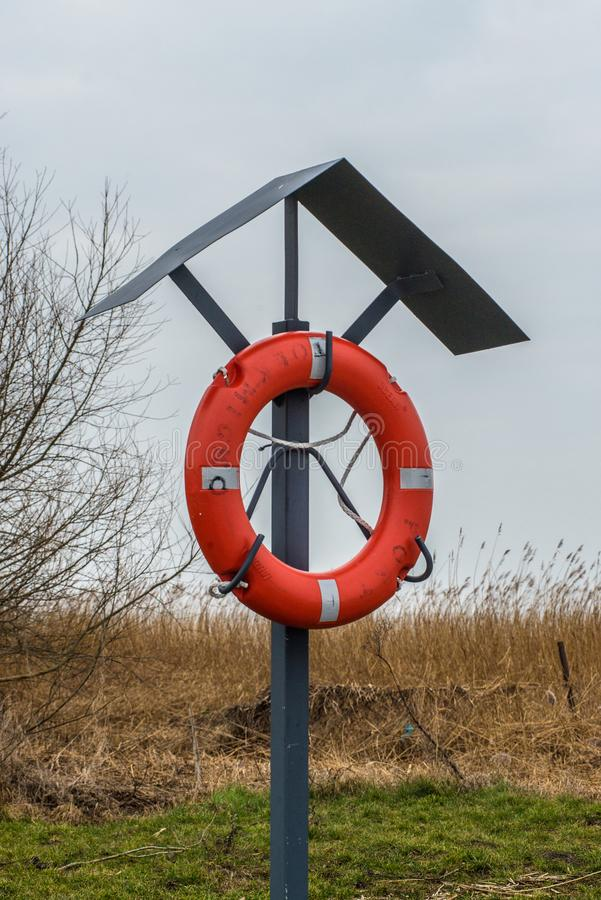 Lifebuoy stand in a small harbor royalty free stock photography