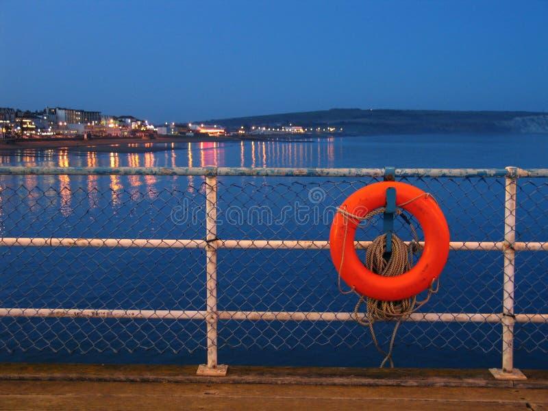 Download Lifebuoy vermelho imagem de stock. Imagem de ajuda, oceano - 101181