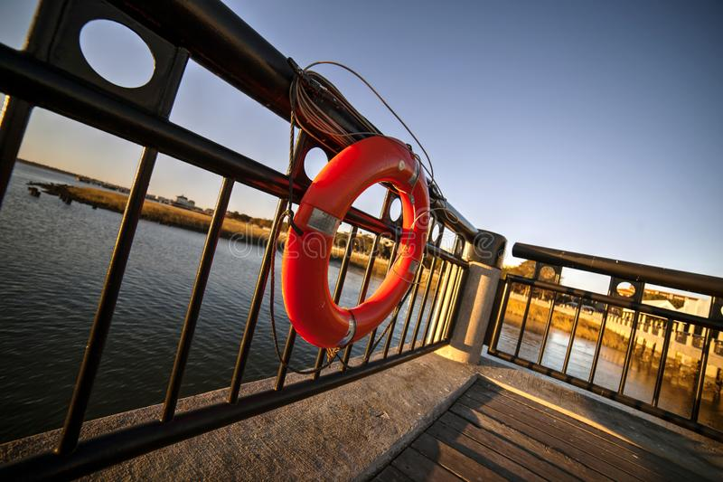 Lifebuoy on viewing platform of pier royalty free stock photos