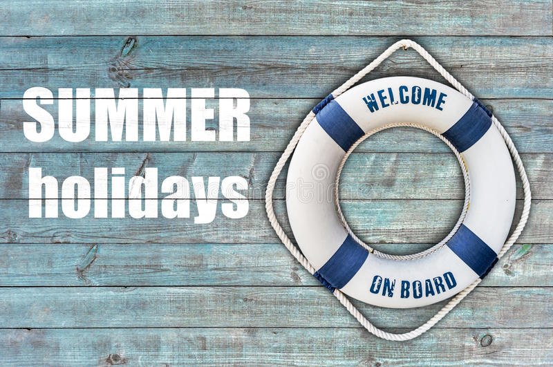 Lifebuoy on wooden floor and summer holidays. Close stock photography