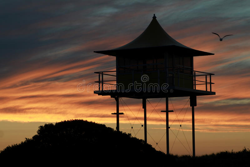 Lifegard lookout tower. Picture of the beautiful silhouette of a lifeguard lookout tower at a beach in South Australia. Towers like this one is a common feature royalty free stock image