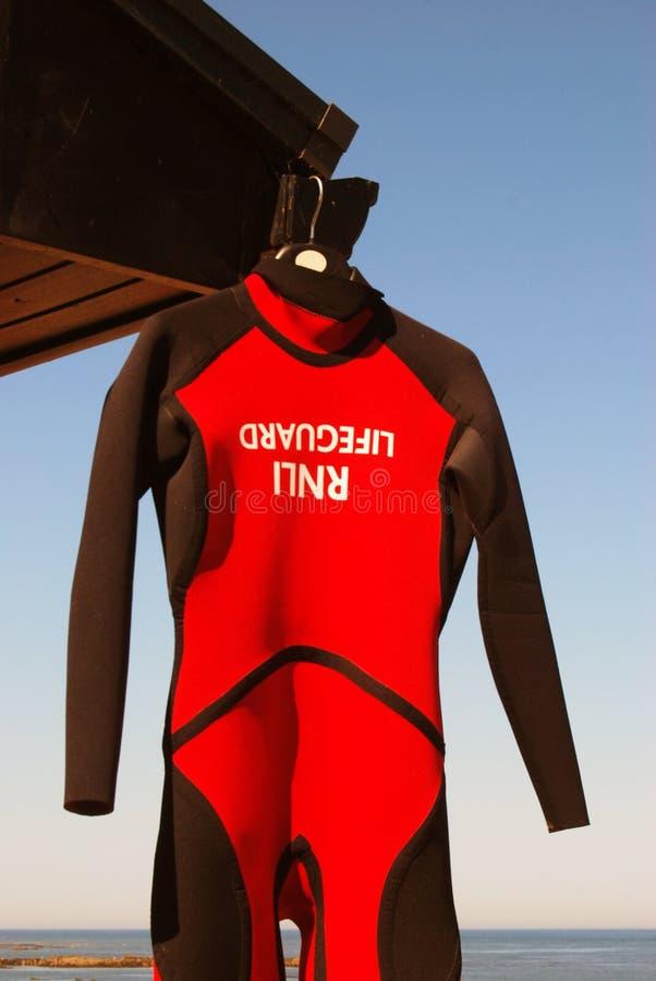 Lifegard wet suit. RNLI Lifeguard wet suit hands from coat hanger royalty free stock images