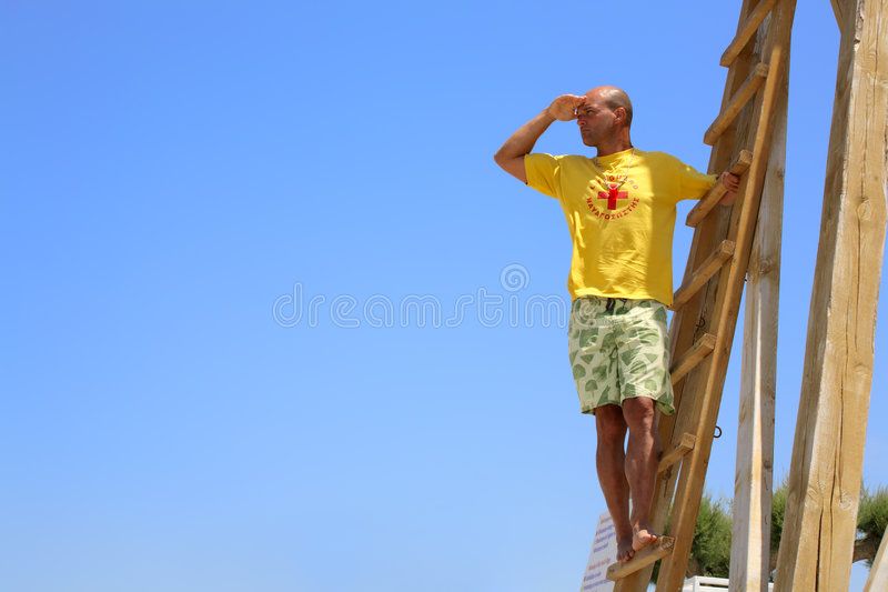 Lifeguard on duty. Male lifeguard on duty, sky background, plenty of copyspace royalty free stock photography