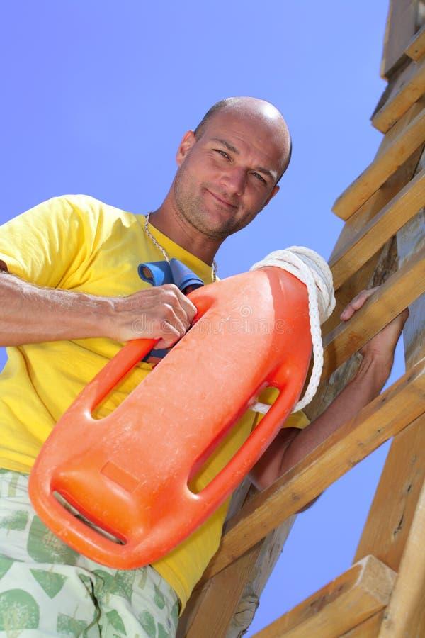 Lifeguard on duty. Male lifeguard on duty, sky background stock photo