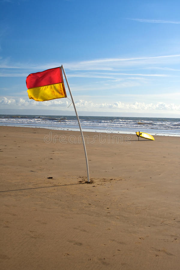 Download Lifeguard Flag And Surfboard Stock Image - Image: 16550753