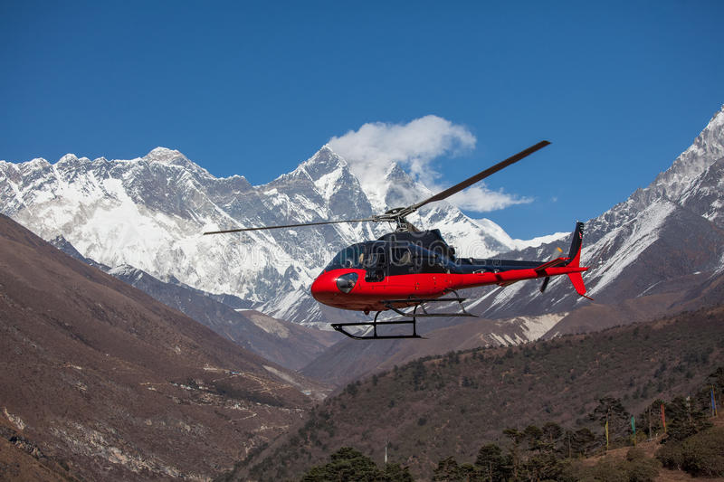 Lifeguard helicopter in Himalaya mountains. In Nepal stock photography