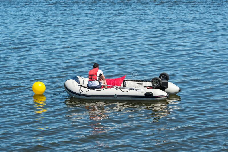 Lifeguard in an inflatable rescue boat stock photo
