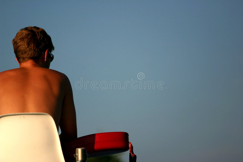 Lifeguard keeping watch royalty free stock image