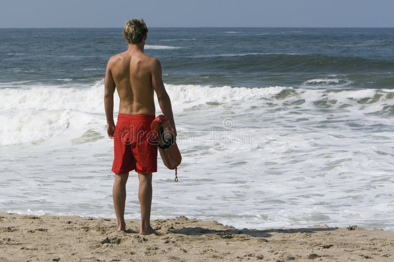 Lifeguard looking out onto ocean royalty free stock image