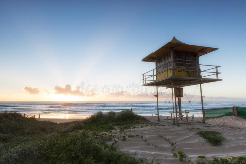 Lifeguard patrol tower on the beach at sunrise, Gold Coast Australia. Lifeguard patrol tower on the beach with clear sky at sunrise, Gold Coast Australia stock photo