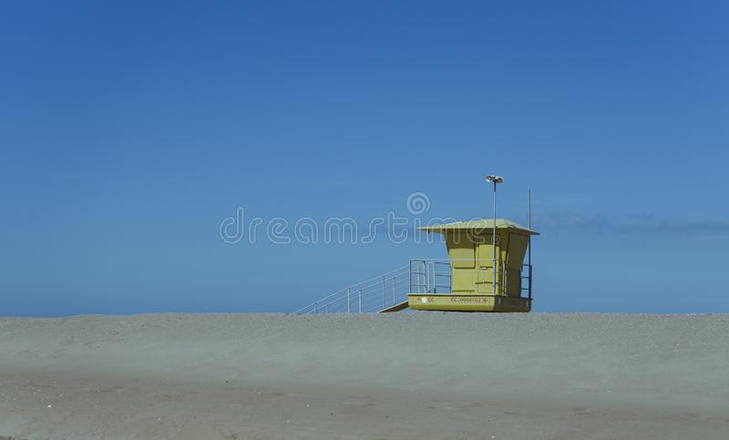 Lifeguard post on the beach. Yellow stock photography