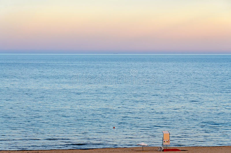 Lifeguard post at the Black Sea shore from Albena, Bulgaria. With golden sands, blue fresh water, sunset royalty free stock image