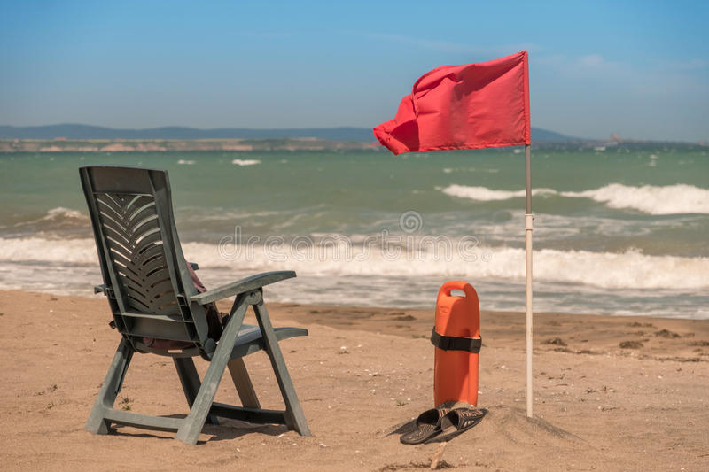 Lifeguard post on sea shore. Lifeguard post on an empty sea shore in waiting for tourists royalty free stock photography