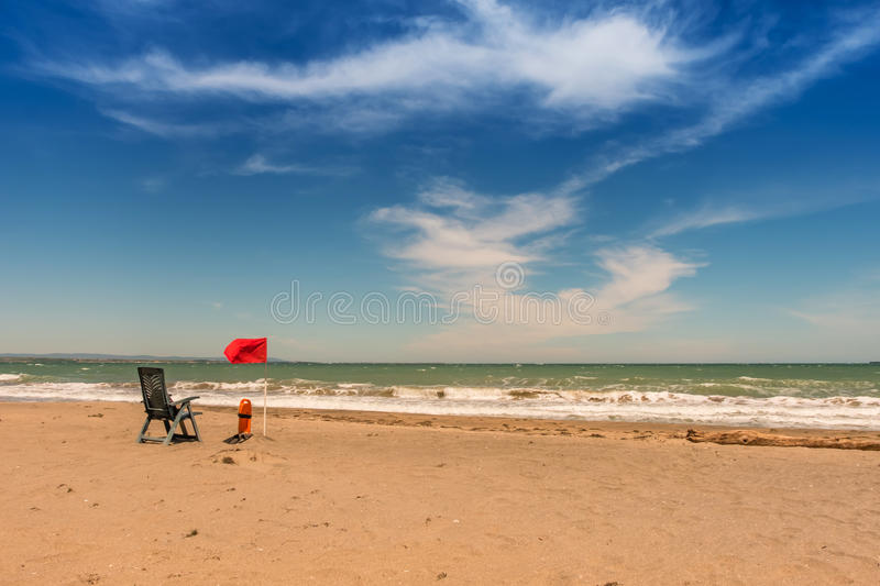 Lifeguard post on sea shore. Lifeguard post on an empty sea shore in waiting for tourists stock images