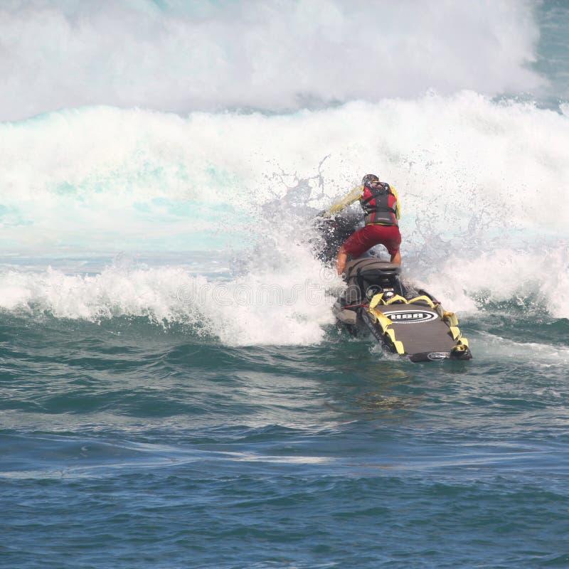 Lifeguard practicing ocean rescue stock photo