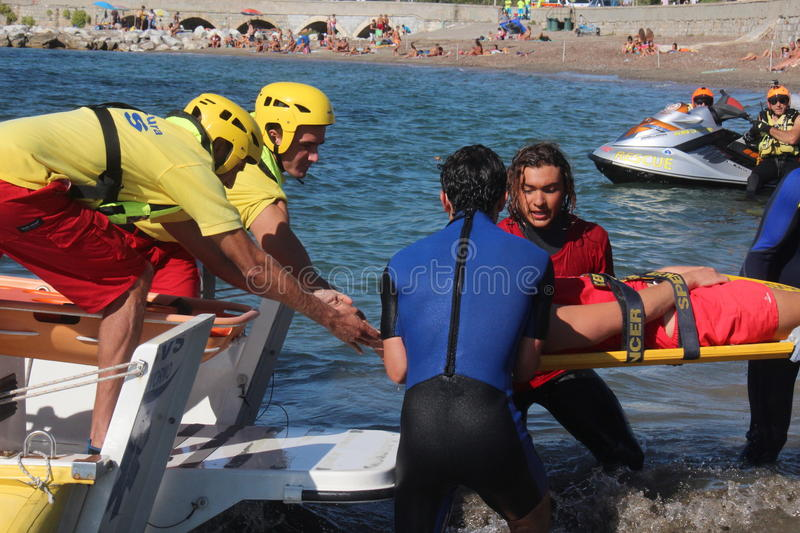 Lifeguard saves swimmer Rescue at sea royalty free stock photography