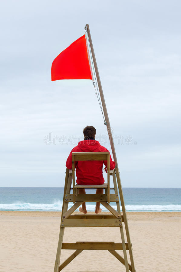 Free Lifeguard Sitting In His Chair Royalty Free Stock Image - 9795156