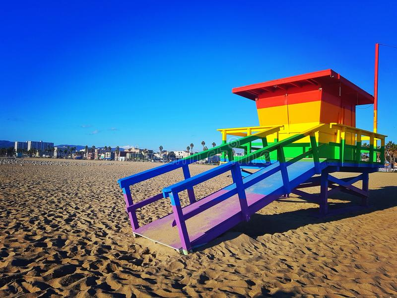 beautiful beach of venice beach with multicolored lifeguard station stock photography