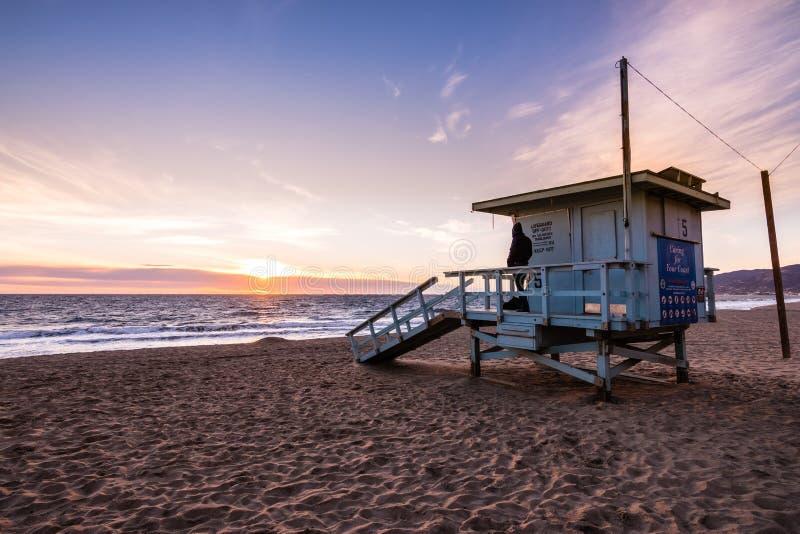 Lifeguard tower on one of the sandy Malibu beaches; beautiful sunset light; Pacific Ocean coastline, California royalty free stock photos