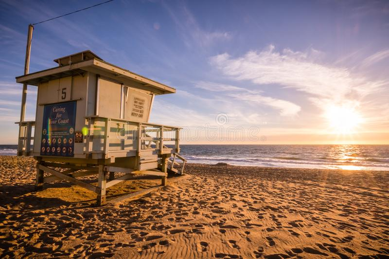Lifeguard tower on one of the sandy Malibu beaches; beautiful sunset light; Pacific Ocean coastline, California royalty free stock image