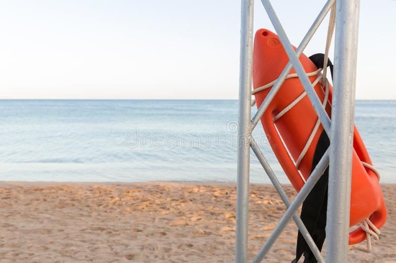 Lifeguard tower with orange buoy on the beach. rescue buoy on the iron rescue post.  stock photos