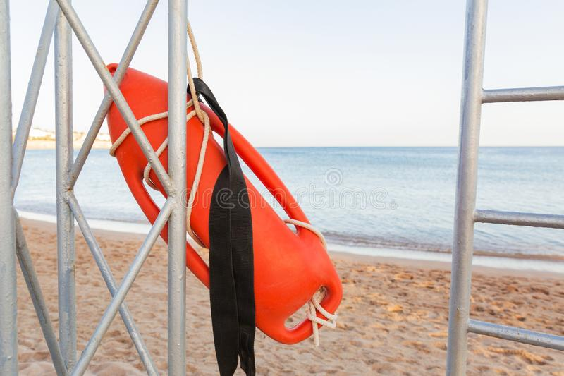 Lifeguard tower with orange buoy on the beach. rescue buoy on the iron rescue post.  stock photo