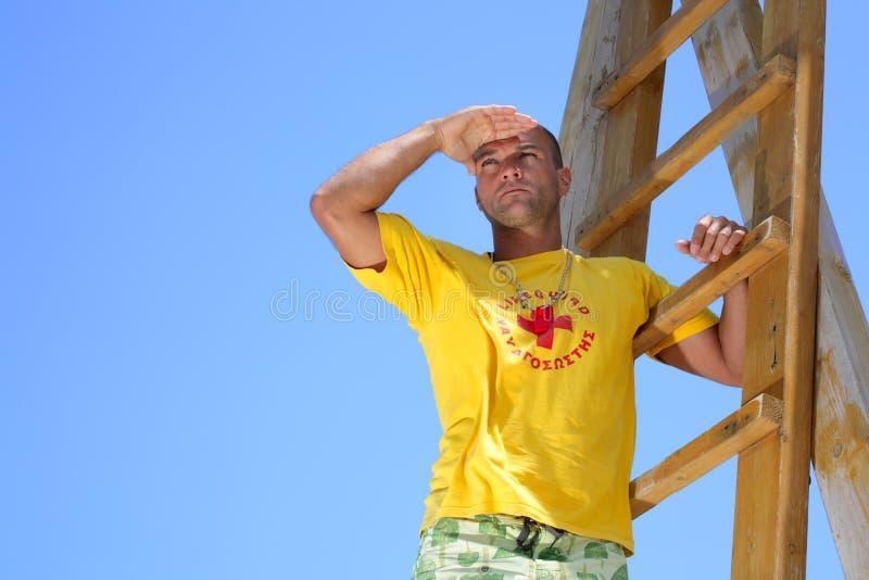 Lifeguard on Watch. A watchful lifeguard checking the horizon royalty free stock image