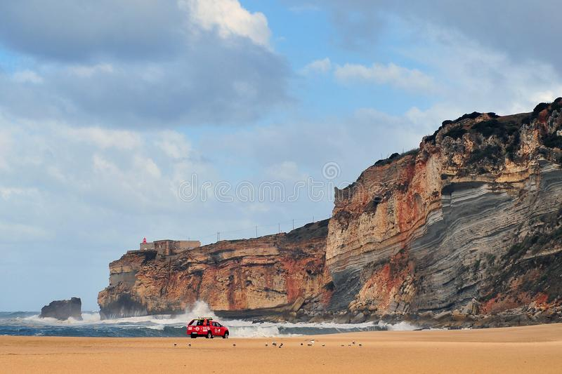 Lifeguards car driving by the beach of Nazare, Portugal royalty free stock images