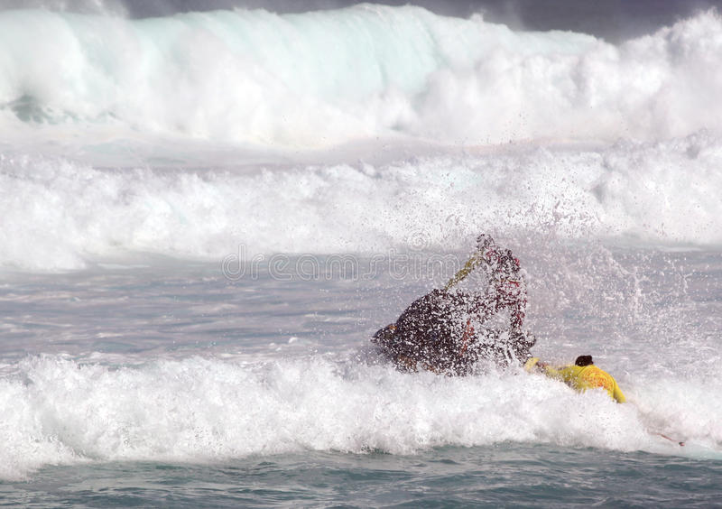 Lifeguards practicing ocean rescues stock images