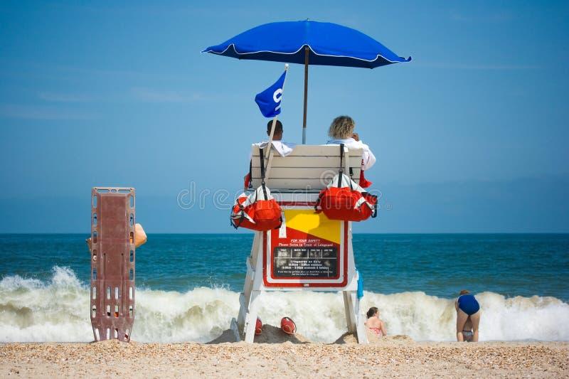 Lifeguards watching beach stock image