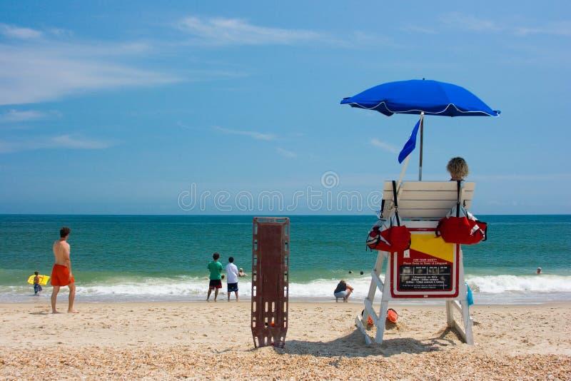 Lifeguards watching beach stock photos