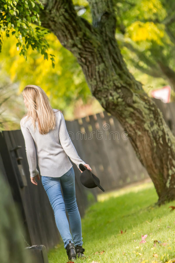 Lifestile outdoor portrait of young beautiful woman on natural b. Ackground royalty free stock image