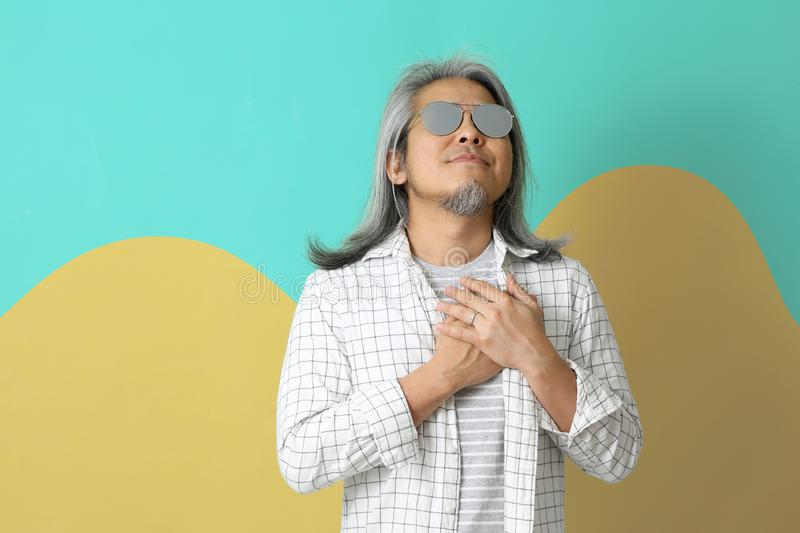 Lifestyle. The Asian man on the colorful background stock images