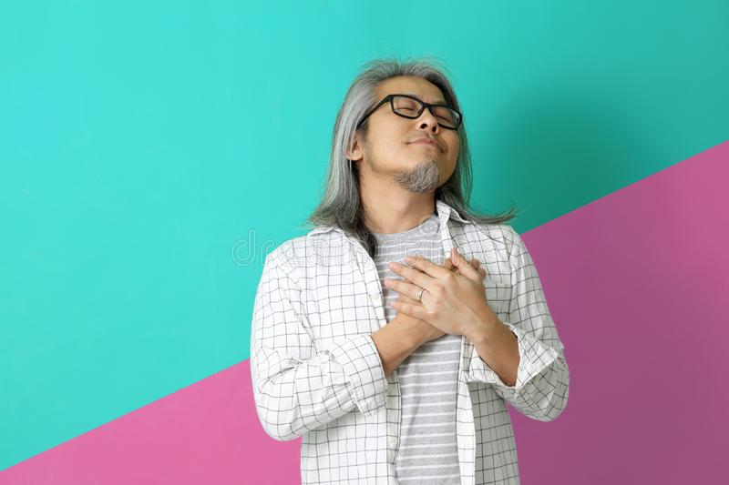 Lifestyle. The Asian man on the colorful background royalty free stock images