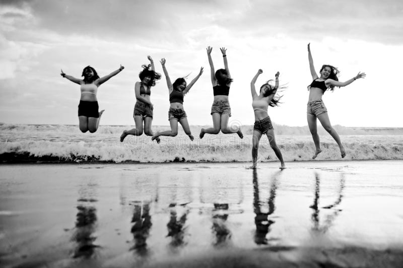 Lifestyle beach portrait of young group of Asian Korean and Chinese women , happy and attractive girlfriends enjoying Summer holid royalty free stock images