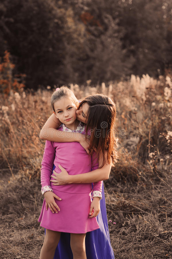 Lifestyle capture of happy mother and preteen daughter having fun outdoor. Loving family spending time together on the walk. stock images