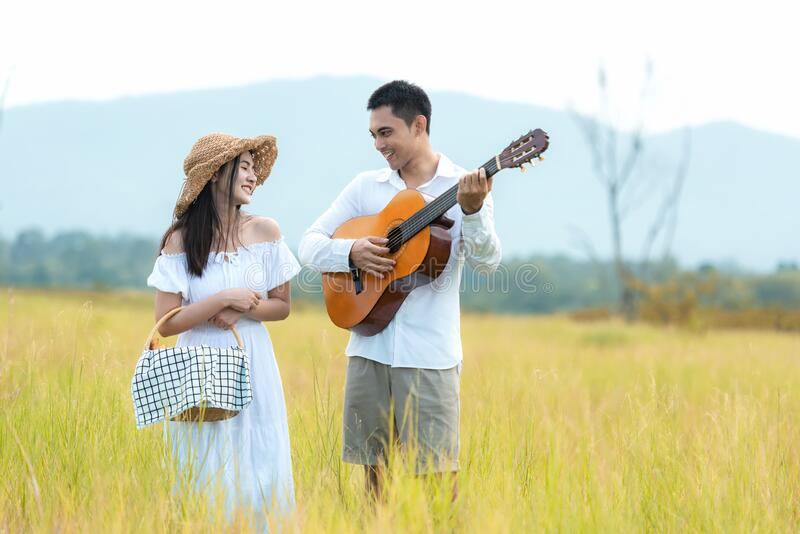 Lifestyle couple picnic and relax. People young woman and man having fun royalty free stock photography