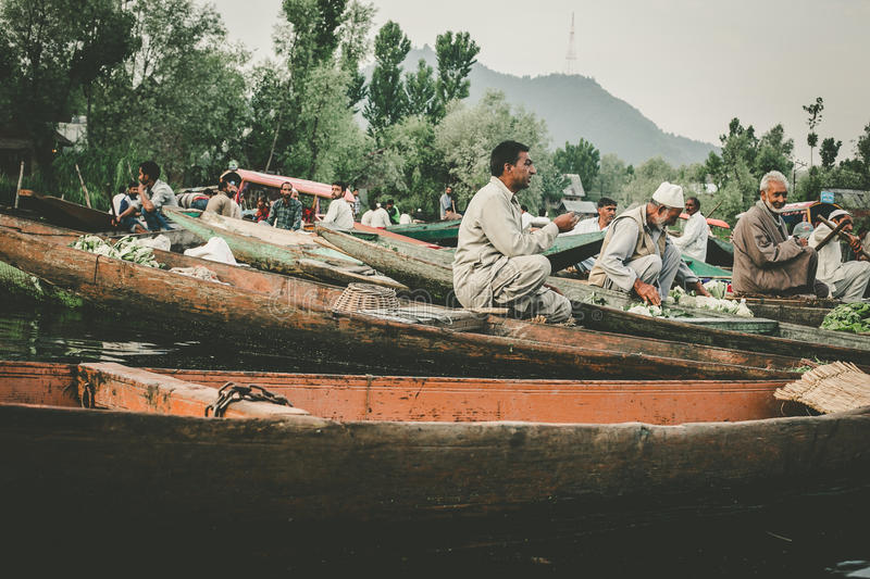 Lifestyle in Dal lake,Kashmiri men sell their vegetables at a floating market in the early hours before sunrise. SRINAGAR,INDIA -JULY 30: Lifestyle in Dal lake stock photos